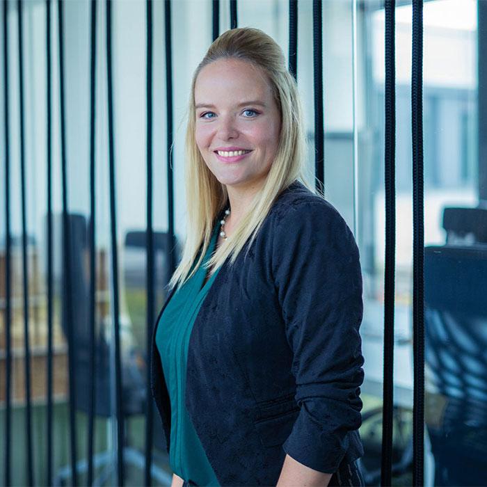 HR expert smiles in front of meeting room